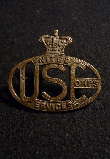 UNITED SERVICES CORPS CAP BADGE